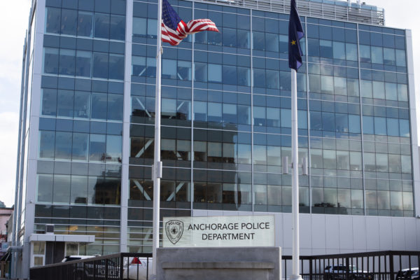 sign in front of building that says: anchorage police department