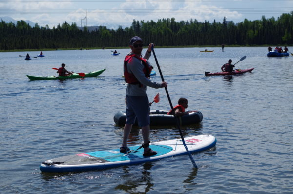 A paddle boarder on Goose Lake