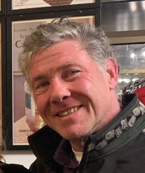 Man in bar. gray hair.