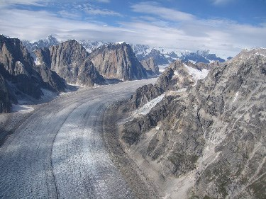 A glacier in a narrow series of granite mountains as seen from above