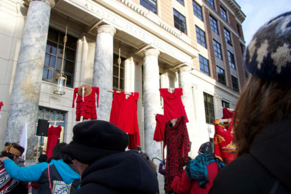 Red shirts hang in front of the capitol building