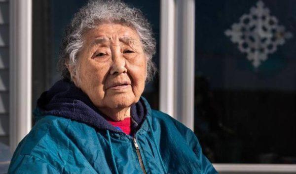 An Alaska Native woman in a blue jacket