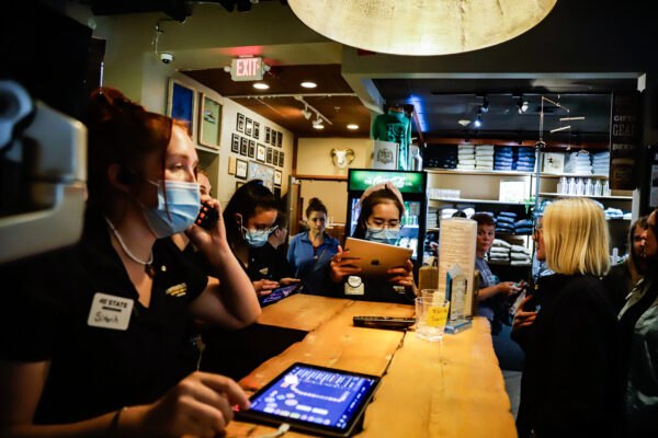 restaurant hosts answer phones and coordinate for diners to get seated