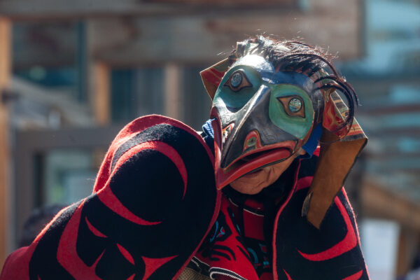 A person wearing a colorful mask.