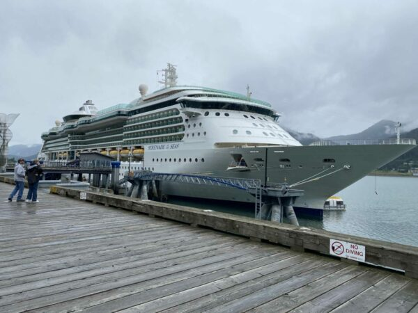 A cruise ship at a dock on an overcast day.