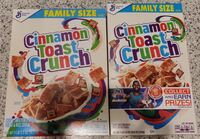 Two boxes of Cinnamon toast Crunch, the one of the left smaller than the one on the right.
