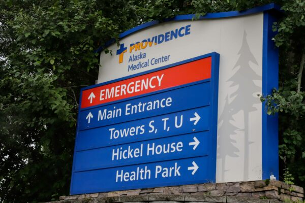 an entrance sign to Providence Alaska Medical Center with arrows pointing to various buildings