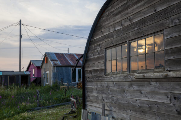 A row of homes in evening light.