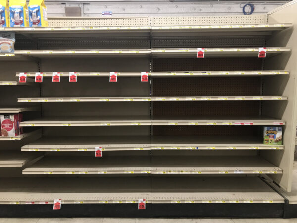 Several empty shelves at a grocery store.