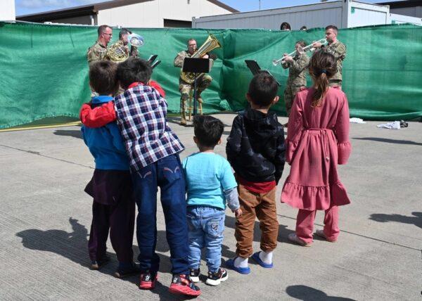 children watch a brass band.