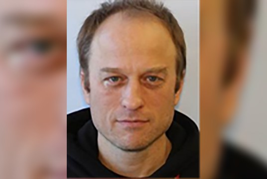 A white balding man's mugshot
