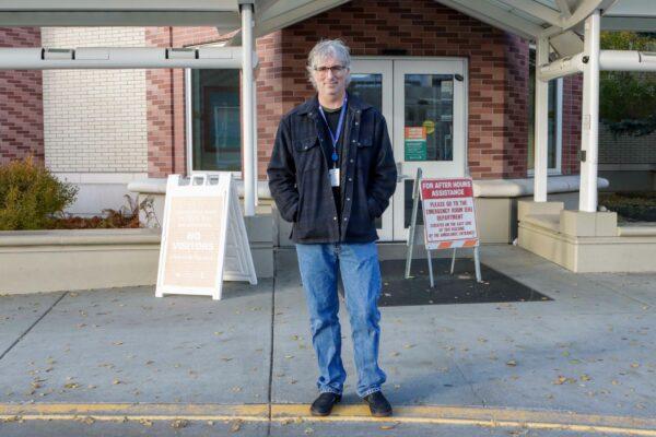 Dr. Matt Hirschfeld poses in front of the Alaska Native Medical Center