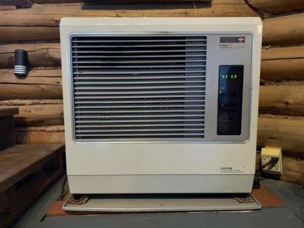 A square, beige heater.